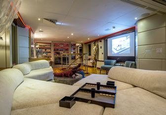 deep sofas and widescreen screen in the skylounge of superyacht ZULU