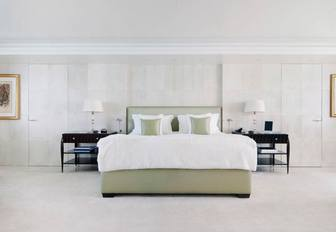 master suite decorated in a neutral colour palette with duck egg green accents on board luxury yacht Lady E