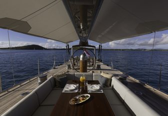dining table in the cockpit of charter yacht RAINBOW
