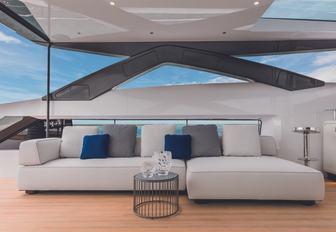 sumptuous sofa under the radar arch on the sundeck aboard luxury yacht Vista Blue