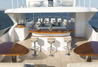 seating areas, bar and Jacuzzi on the sundeck of motor yacht Far From It
