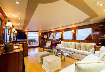 the traditionally styled main salon on board luxury yacht LIBERTUS