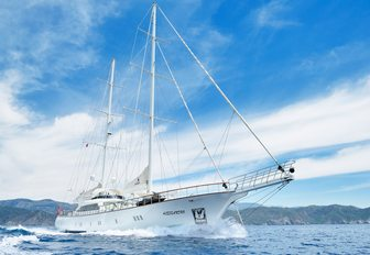 luxury yacht ALESSANDRO cuts through the water during a private yacht charter