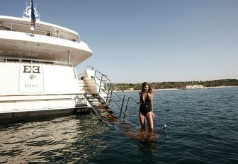 charter guest gets close to the water on swim platform aboard superyacht E&E