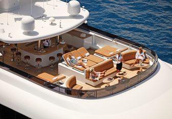 sun pads, seating and bar on the sundeck of motor yacht Martha Ann