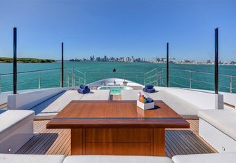 U-shaped seating and spa pool forward on the Portuguese bow aboard charter yacht Drew