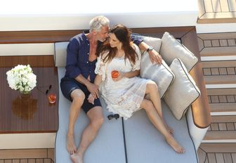 a couple enjoy a romantic moment while on their luuxury yacht charter vacation in the caribbean