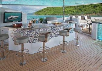 sleek bar next to Jacuzzi on the sundeck of motor yacht Muchos Mas