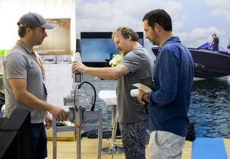 visitors at the Thailand Yacht Show & Rendezvous talk to an exhibitor