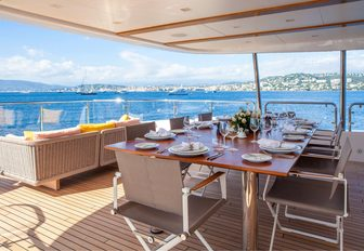 alfresco dining under the shade on the upper deck aft of motor yacht DYNAR
