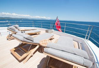 sun loungers line up on the sundeck of motor yacht JACOZAMI