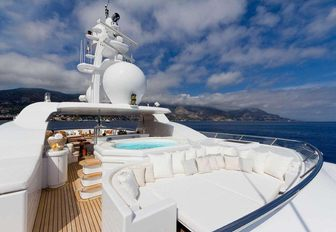 chic sundeck with Jacuzzi and sunpads aboard motor yacht HANIKON