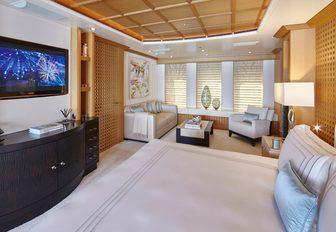 beautifully styled master suite with lounge area aboard superyacht HANIKON