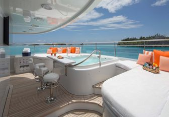superyacht sundeck with jacuzzi and bar stools