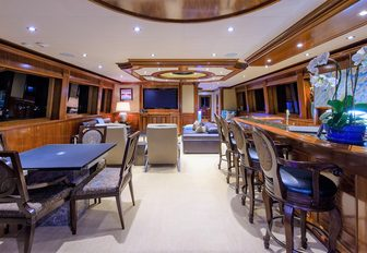 bar and games table in the elegant skylounge aboard luxury yacht EXCELLENCE