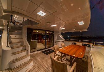 aft deck of superyacht Antonia II with alfresco dining setup