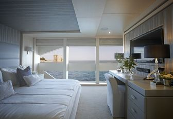 VIP suite with full-length windows on board luxury yacht ARADOS