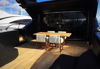 Small table with chairs on charter yacht NEOPRENE