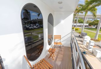 one of the stateroom's balcony with table and chairs on board luxury yacht GLOBAL