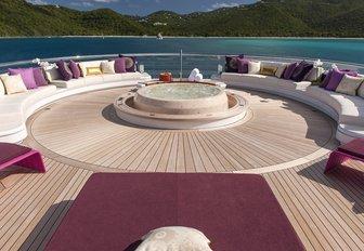 sundeck Jacuzzi surrounded by seating aboard luxury yacht SOLANDGE