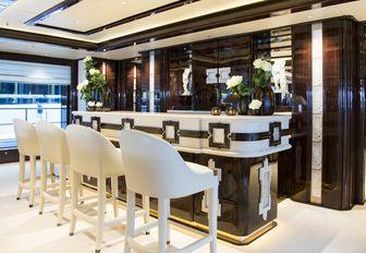 main salon bar, one of five bars aboard charter yacht 'Illusion V'