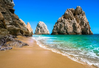 beautiful white sand beach with turquoise waters and dramatic rock formations in the Baja Peninsula, Mexico