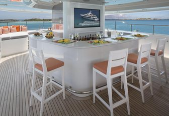 bar with stools and TV screen on the sundeck of luxury yacht Time For Us