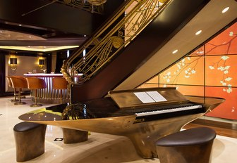 Charter yacht KISMET stairwell and piano with LED light panels in hallway