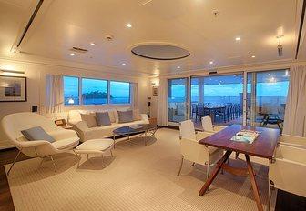 beach house style interior of main salon aboard expedition yacht SENSES