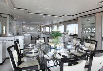 chic dining area with glass dining table aboard motor yacht SEALYON