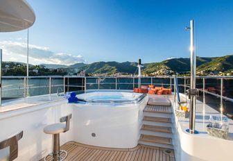 raised Jacuzzi and bar on the sundeck of luxury yacht DIANE