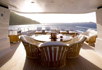 Sun deck and dining area on board luxury yacht HARLE