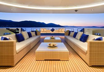 luxe seating area on the main deck aft of luxury yacht Mary-Jean II at sunset