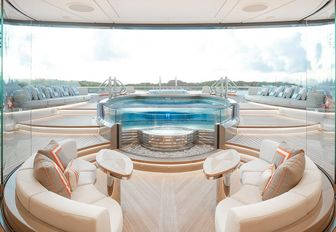 seating area and swimming pool on board charter yacht KISMET