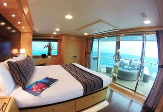 luxe master suite with private outdoor terrace aboard luxury yacht 'Mystic Tide'