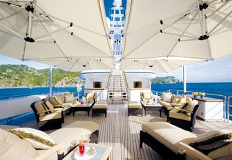 seating area shaded by umbrellas on the split-level sundeck of motor yacht UTOPIA