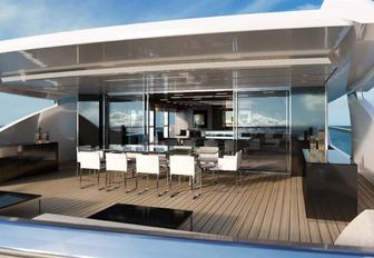 The alfresco dining section included on the exterior of motor yacht Seven Sins