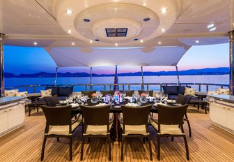 alfresco dining set up on the upper deck aft on board charter yacht Lucky Lady