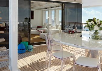 heesen yacht home seating area with glass table