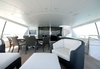 seating and dining area on the upper deck aft of luxury yacht 'Elena Nueve'