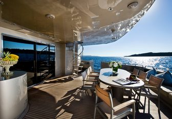 chic alfresco dining area on aft deck of charter yacht PANDION