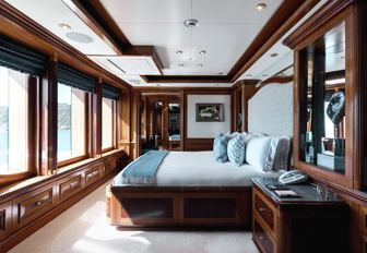 guest cabin on m/y titania, with bed overlooking views