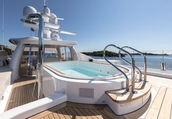 An image of the large swimming pool featured on board superyacht LILI
