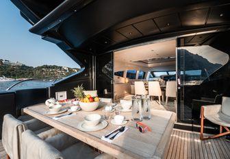Outdoor dining area looking inside on charter yacht NEOPRENE