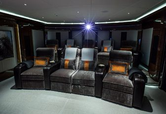 cinema lounge on charter yacht excellence v, with sumptuous chairs