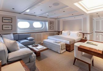 Large cabin with bed and sofas on explorer yacht 'Blue II'