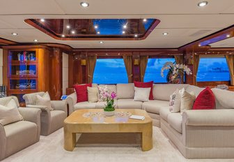 the grand and sophisticated main salon of charter yacht quintessa in the evening while on her caribbean yacht charter