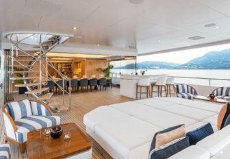 sunpads, bar and winter garden on the aft deck of luxury yacht JOY