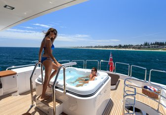 charter guest steps into luxury yacht jacuzzi