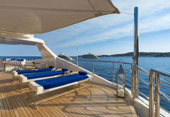 Trio of massage tables on exterior deck facing the sea onboard M/Y SERENITY
